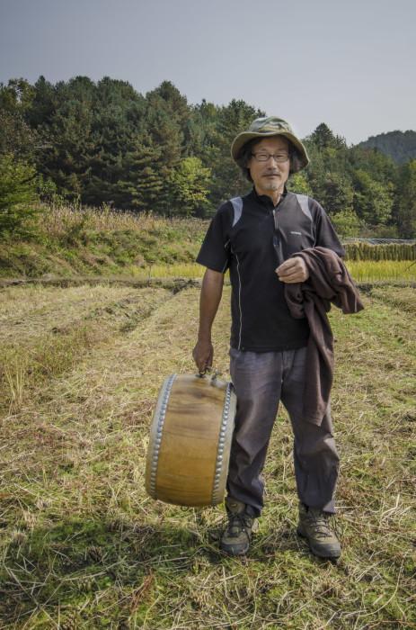 Seonghyun Choi at his natural rice farm after harvest time in Hongcheon, South Korea (photo, P.M. Lydon / Final Straw)