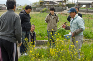 Okitsu with locals at his natural farm in Shikoku