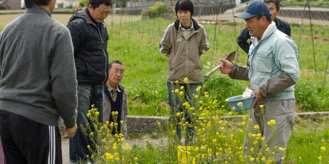 Okitsu with locals at his natural farm in Shikoku