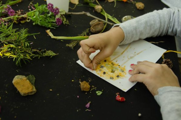 A child paints with natural materials during a SocieCity workshop at Yangjae Citizen's Forest in South Korea (photo by SocieCity Collective)